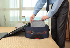 Businessman packing a suitcase Royalty Free Stock Photography