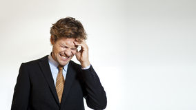 Businessman in pain from headache Royalty Free Stock Images