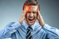 Businessman with pain in his temples. Stock Image
