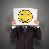 Businessman with the painted happy smile Stock Image