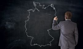 Businessman painting Germany map on blackboard concept.  royalty free stock photos