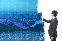 Businessman painting graphs stock photos