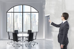 Businessman painting a room Royalty Free Stock Images