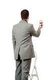 Businessman Painting A Sign Royalty Free Stock Photo