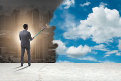 The businessman painting sky and clouds Royalty Free Stock Images