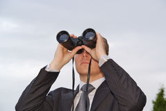 Businessman with a pair of binoculars Stock Image