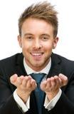 Businessman with palms up Stock Photos