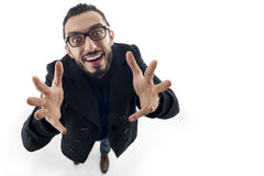 Businessman with palms up shot in wide angle Royalty Free Stock Images