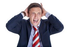 Businessman in panic. Businessman in blue suit holding head in panic Stock Photo