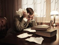 Businessman in panic behind table Royalty Free Stock Photography