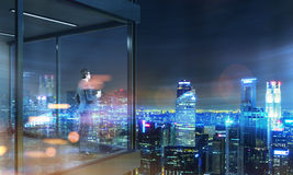 Businessman on panoramic balcony night Stock Photo