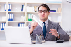 The businessman with paper airplane in office Stock Photos