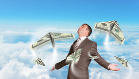 Businessman with paper airplanes made of hundred Royalty Free Stock Image