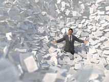 Businessman in a paper avalanche Royalty Free Stock Photography