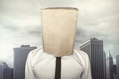 Businessman with a paper bag on head Royalty Free Stock Image