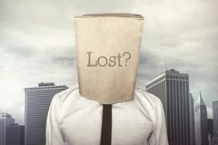 Businessman with a paper bag on head with lost Royalty Free Stock Image