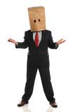 Businessman With Paper Bag over Head Royalty Free Stock Images