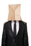 Businessman with paper bag over his head Royalty Free Stock Image