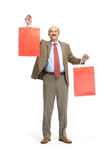 Businessman and paper bags Royalty Free Stock Photos