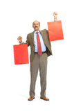 Businessman and paper bags Stock Image