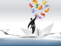 Businessman on paper boat Royalty Free Stock Photography