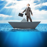 Businessman in paper boat Stock Photos
