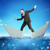 Businessman in paper boat Stock Images