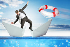Businessman in paper boat Stock Image