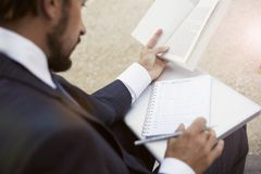 A businessman with paper documents and laptop Royalty Free Stock Photography