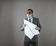 Businessman with paper plane and goggles Royalty Free Stock Photography