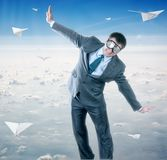 Businessman with paper plane and goggles Royalty Free Stock Images