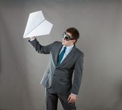 Businessman with paper plane and goggles Stock Photo
