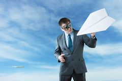 Businessman with paper plane and goggles Royalty Free Stock Photo