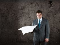 Businessman with paper plane in studio Stock Image