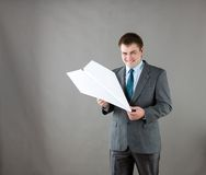 Businessman with paper plane in studio Stock Photos