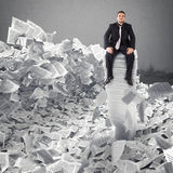 Businessman with paper sheet anywhere. Buried by bureaucracy concept. Stock Images