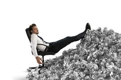 Businessman with paper sheet anywhere. Buried by bureaucracy. Concept of overwork. Businessman with paper sheet anywhere in office. Buried by bureaucracy royalty free stock images