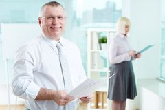 Businessman with papers Royalty Free Stock Photos