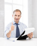 Businessman with papers showing thumbs up Royalty Free Stock Photo