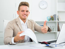 Businessman with paperwork and thumb up Stock Photos