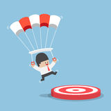 Businessman with a parachute focus to landing on a target Stock Photography