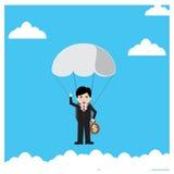 Businessman parachute jump Stock Photos