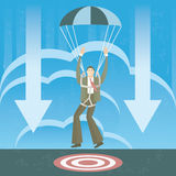 Businessman in parachute landing on the target Stock Image