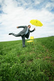Businessman with parasol  Stock Photos
