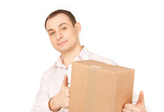 Businessman with parcel Stock Images
