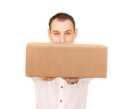 Businessman with parcel Royalty Free Stock Image