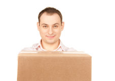 Businessman with parcel Royalty Free Stock Photos