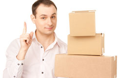 Businessman with parcels Royalty Free Stock Photography