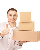 Businessman with parcels Royalty Free Stock Photos