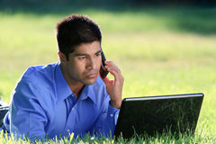 Businessman at the park. Young businessman working with laptop at the park Stock Images